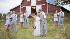 love how the bridal party is staggered in front of the barn!