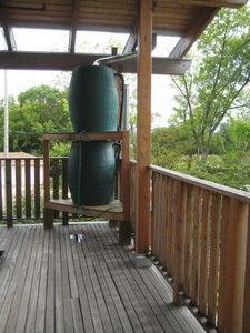 A gravity-fed rainwater collection system - rain barrels! photo by vinzcha on Flickr