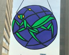 This mantis suncatcher is made of violet, green and yellow baoli glass and consists of 43 pieces of glass. Stained Glass Art, Stained Glass Windows, Insect Art, Window Hanging, Suncatchers, Etsy Seller, Unique Jewelry, Handmade Gifts, Artist