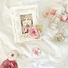 """I used a lot of Prima's different mixed media goodies to alter this little box. I put a layer of White crackle paste for the background, I am so addicted to it! I colored the metal embellishments with the Color Bloom Pearl White and Cotton Candy."""" ~ Nathalie Dalibard #makeitprima #challenge #april"""