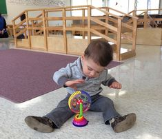 A throwback to Nicolas completely engaged in a single toy in his school playgroup.