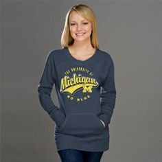 Michigan Wolverines Heather Navy Women's Swept Up Scoop Neck Sweatshirt by New Agenda. $42.99. Cozy on up with some Wolverines team spirit with this Michigan Wolverines Heather Navy Women's Swept Up Scoop Neck Sweatshirt. This stylish piece of Michigan Wolverines apparel features a weathered screen print graphic of your team's logo and wordmark that will surely show off your undying admiration for your Michigan Wolverines. Comes with front kangaroo pocket to keep your hands nic...