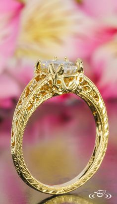 Golden filigree curls adorn the under gallery of this stunning yellow gold #EngagementRing. #Love #GreenLakeJewelry #BeMyValentine
