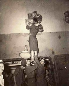 "This photo shows Marlene Dietrich passionately kissing a GI as he arrives home from World War II. It seems that the guy on the left holding her up is enjoying the view. It was first published in Life Magazine with the caption: ""While soldiers hold her up by her famous legs, Marlene Dietrich is kissed by a homecoming GI"". Photo taken by Irving Haberman.  ♥♥♥"