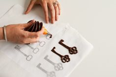 This would be a cute thing to do on top of cupcakes... make them out of chocolate and let them set up.