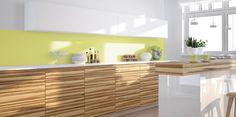 Ta kuchnia spodoba się osobom lubiącym żywe kolory. Świeża limonka i złamana biel to doskonała propozycja dla tych, którzy codziennie czerpią siłę z natury. Idealnym uzupełnieniem wnętrza są drewniane dodatki i delikatna roślinność.