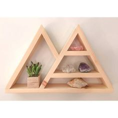 This geometric shelf can serve as a unique crystal/jewelry display or shadow box.  Measurements: height 12in x base width 19in x depth 2.5in