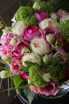 Really beautiful arrangement, almost musical: Roses, ranunculus, hydrangea, fritillaria and viburnum