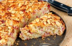 French Rhubarb Cake      Ingredients:    *  6-7 cups rhubarb, medium diced  *  8 tablespoons or 1 stick butter  *  1 1/4 cups sugar  *  1 teaspoon vanilla extract  *  3 eggs  *  1 2/3 cups flour  *  2 teaspoons baking powder  *  1/8 teaspoon salt
