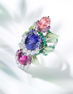 Bright gemstones and floral motifs have been creatively combined to form this fabulous Fabergé ring from the new Secret Garden high jewellery collection.