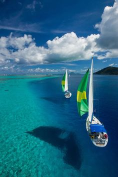 Raiatea - French Polynesia. I love water that is so clear it looks like the boats are floating in the air! I want to go swimming there!
