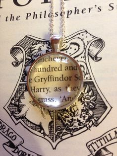 Harry Potter Gryffindor Book Page Necklace by EnchantingGlass