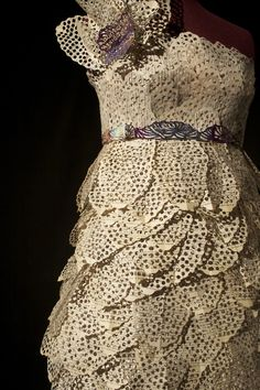 dress made from book pages and hole punch