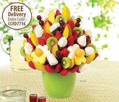 This sweet summer fruit bouquet is bursting with white chocolate dipped strawberries and oranges topped with fresh shaved coconut, white and semisweet chocolate dipped bananas with coconut, juicy pineapples dipped in white chocolate, plus grapes, mango and kiwi. YUM! #gococonuts for #sweetsavings with #ediblearrangements