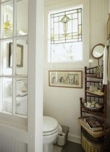 Small Bathroom Decorating.  Love the stained glass in the window