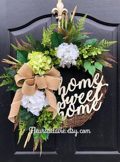 Gorgeous Elegant Year Round Door Wreath! Perfect for greeting your guests to your home with this one of a kind door wreath. Made up on an 18 grapevine wreath with moss, mixed flowing greenery of ivies, boxwood, eucalyptus, hydrangeas leaves, ficus leaves and ferns. Beautiful white and