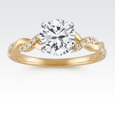 We're swooning over this charming infinity ring in yellow gold. #ShaneCo #ShaneCoSparkle