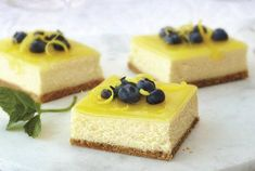 Put a luscious lemon glaze on these Double-Lemon Cheesecake Bars for a finishing touch. You're sure to love the tangy-sweet taste of our delicious Double-Lemon Cheesecake Bars. Köstliche Desserts, Lemon Desserts, Lemon Recipes, Delicious Desserts, Dessert Recipes, Yummy Food, Easter Desserts, Cheese Recipes, Easter Treats