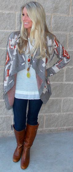 Aztec cardigan, white top, dark skinnies, brown boots, fun necklace
