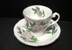 Clarence Bone China Floral Cup and Saucer Made England white red green