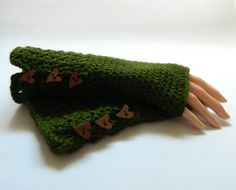 warm and cozy crochet fingerless mittens, wristwarmers, handmade from soft acrylic yarn with wooden heart buttons on the cuffs. The cuffs can be unbuttoned, but the mittens are wide enough just to be slipped on. These mittens are available in a variety of colours, so check out other listings or just convo me if you would like a different colour  All the items I sell are handmade by me, I do not mass produce, making each one of them very special gifts. Everything is made with great care and…