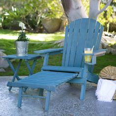 The classic lounge chair gets a modern update with this Blue-Stain Wood Adirondack Chair with Pull Out Ottoman and Built in Cup Holder. This isn't your typical Adirondack chair. Its ergonomic structure features the traditionally Plans Chaise Adirondack, Wood Adirondack Chairs, Wooden Chairs, Fire Pit Furniture, Outside Furniture, Outdoor Furniture, Rustic Chair, Rustic Furniture, Diy Furniture