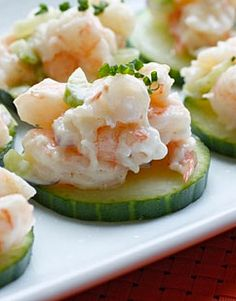 Seafood Salad with Egg, Celery, Scallion & Sour Cream on Cucumber Slices  http://www.recipe.com/dilled-seafood-salad/