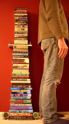 How many books would you have to read to build a stack of books taller than yourself? [photo by Jay the book nerd]