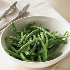 Sesame oil adds a delicate, nutty flavor to crisp green beans; a sprinkling of sesame seeds on top adds texture.
