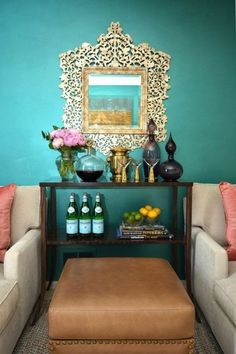 """<p>Dress up any plain bar cart by setting it against a jewel-toned wall and metallic mirror. Add fresh flowers and bright, seasonal fruits for the perfect summer cocktail setting.</p><p><a href=""""http://www.thedecorista.com/""""></a><em><a href=""""http://www.thedecorista.com/"""" target=""""_blank"""">Via The Decorista</a> </em></p>"""