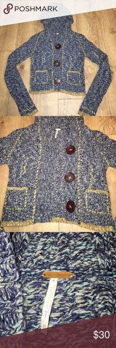 Free People Sweater Free People Sweater. Perfect condition. Size XS. 3 large buttons & 2 pockets on the front. Has a hood. Nice, thick knit fabric. Only worn twice. Free People Sweaters