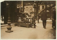 Lewis Wickes Hine. Bootblack, 3rd Ave & 9th St. Location: New York, New York (State). 1910 July. Library of Congress.