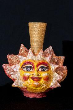 J'aime cet vase parce que, j'aime le 3D de la soleil et aussi les  couleurs dans là et que sa fit ensemble.