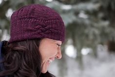 This hat is created in two pieces. First the brim is knit and joined into a band. Stitches are then picked up along one side of the band and joined for knitting in the round to work the remainder of the hat up to the crown. This hat is designed to be worn with the cable pattern on the side of the head for a vintage, 1920's flapper style.