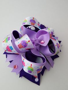 Check out this item in my Etsy shop https://www.etsy.com/listing/504411189/purple-boutique-hair-bow-cupcake-hair