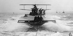 Sopwith Camel on a lighter towed by a Royal Navy destroyer.