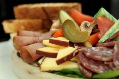 An array of cheeses, cured meats and other tidbits are perfect for nibbling at Olesia's Place, 11204 Royalton Road, North Royalton. Contemporary flourishes and a greenhouse-like environment belie old world flavors and satisfying fare. -- Bob Migra