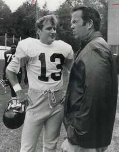 What's that number? Argonaut coach Leo Cahill is surprised to see No. 13 on sweater of quarterback Wally Gabler as latter joins team for his first workout. Canadian Football League, Toronto Star, Library Locations, Photo Archive, Leo, Number, Workout, Sweater, Sweater Cardigan