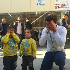 Mika playing peekaboo with twin refugee kids in Lebanon <3