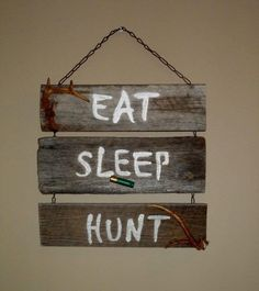 My first pinterest project I made. The wood was free from a pallet, hooks and chain from Lowes, and I used a paint marker. *Picture above is not my product*