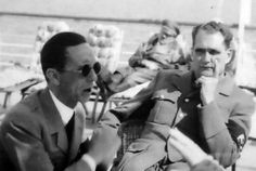 A moment of relaxation for the new rulers of Germany: Goebbels, the Propaganda Minister (with dark glasses) in conversation with an unseen companion, while Rudolf Hess, deputy leader of the Nazi party, is listening. In the background, Hitler is caught dozing off on an easy chair. The photo was apparently taken during one of the Nazi party Baltic Sea cruises so popular before the beginning of the war.