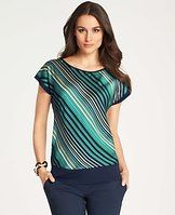 Bias Stripe Dolman Sleeve Top - Mixing a modern silhouette with vibrant stripes, this wear-now look is endlessly chic. Jewel neck. Dolman cap sleeves. Knit banded neckline, sleeves and hem.