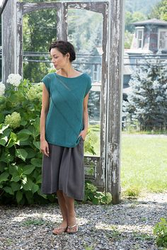 Dropped stitches add an elegant look to this tee. Work both body pieces individually on the bias, then seam after blocking and dropping stitches.