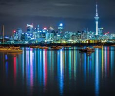 """Auckland, New Zealand by SAM KENNEDY - NEW ZEALAND (@capturenz) on Instagram: """"Bright city lights! How about this reflection across the harbour of the Auckland CBD! #capturenz #Auckland #landscapephotographyNZ"""