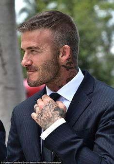 David Beckham cuts a dapper figure as he steps out in Miami Inked: The star flashed his multiple tattoos as he adjusted his tie David Beckham Haircut, David Beckham Style, David Beckham Short Hair, Trendy Haircuts, Haircuts For Men, Mens Medium Length Hairstyles, Hair And Beard Styles, Short Hair Cuts, Men Short Hair