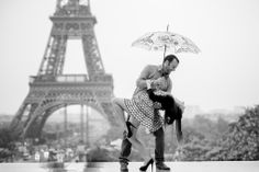 Couple in love dancing in the rain in front of the Eiffel Tower. Embrace the rain in Paris !