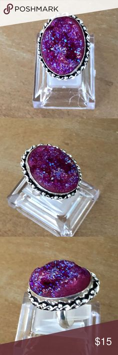 NWOT Faux Druzy Ring Size 8.75 – Purple  WQ47424 NWOT Titanium-look faux druzy ring. Pretty magenta-purple color with nice sparkle.  This is a nice ring with some character.  Approx. Size - main gemstone 18x25mm. Jewelry Rings