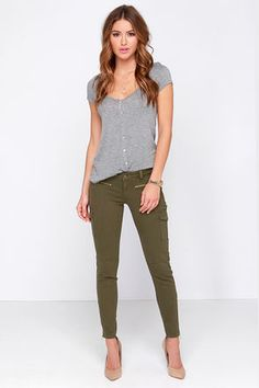 Near or abroad, the Car-Go the Distance Olive Green Cargo Skinny Jeans are your ticket to chic style on the go! Olive green denim offers a bit of stretch in these cool skinnies complete with belt loops, hidden fly with top button closure, and decorative gold zippers at front. Tapered legs have twin cargo pockets with working ankle zips to finish the look. Faux welted back pockets. Unlined. 74% Cotton, 24% Polyester, 2% Spandex. Machine Wash Cold. Imported.