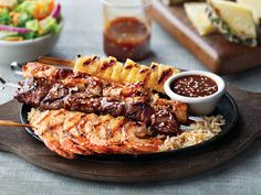 Kick back this holiday. For $17.99, get our new Grilled Teriyaki Trio. Featuring delicious shrimp, white meat chicken and wood-grilled sirloin steak. Don't forget the handmade Teriyaki sauce on the side. Handcrafted with toasted sesame seeds, pineapple and ginger.