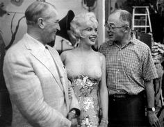 Marilyn Monroe with French singer Maurice Chevalier and director Billy Wilder on the set of Some Like It Hot in 1958